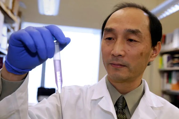 """Liang Wang, an associate professor of pathology at Medical College of Wisconsin, has been doing research on so-called """"liquid biopsies."""" (Rick Wood/Milwaukee Journal Sentinel/TNS)"""