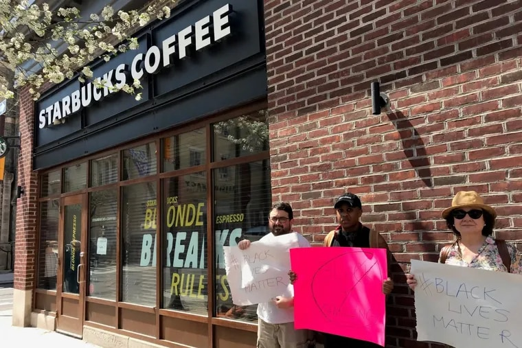 Protesters demonstrate outside the Starbucks at 18th and Spruce Streets.