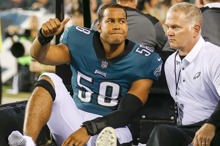 Eagles middle linebacker Jordan Hicks exits the field on a cart after suffering a torn right Achilles tendon in the Redskins game. The injury ended his season. YONG KIM / Staff Photographer