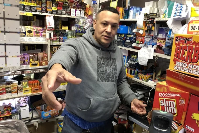 Store owner Elvis Nunez, 53, demonstrating how he defended himself in a shootout with an armed robber Mach 14, 2014. The robber died. Photo taken March 18.