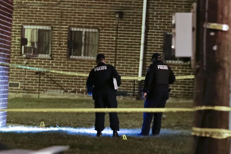 Camden County Police investigate the area where a police officer was shot in the leg by a suspect Wednesday night.