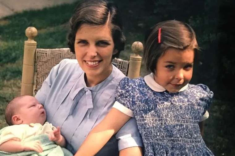 """Mrs. Rhoads, shown here with two of her children, """"inherited the gentle kindness, sense of fun, and appreciation of history which imbued everything she did,"""" her family said."""