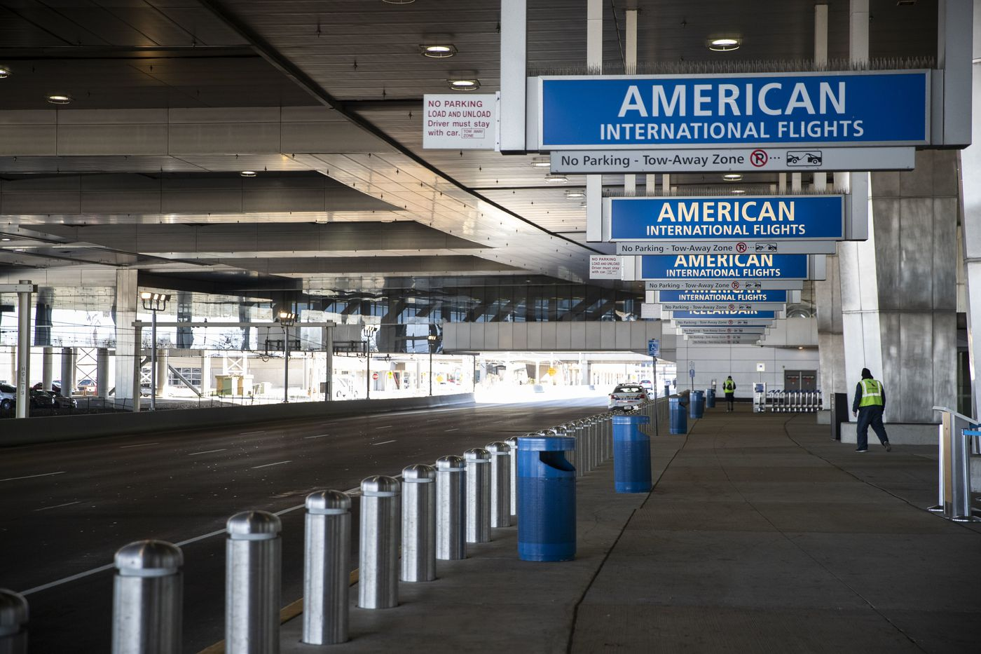 Low traffic outside of the International Check-In at the Philadelphia International Airport in Philadelphia on Monday. Dozens of presumed positive cases of the coronavirus have been reported in Pennsylvania and New Jersey, with the case count escalating daily.