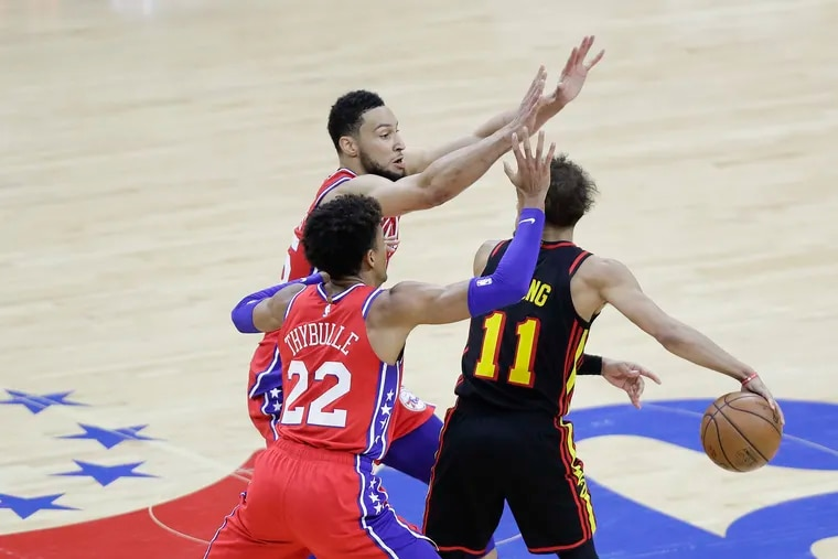 Sixers guards Ben Simmons and Matisse Thybulle defending Atlanta Hawks guard Trae Young in Game 1 of the NBA Eastern Conference playoff semifinals on June 6.