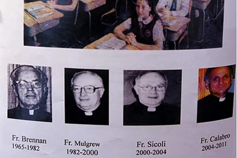 A page with a photograph of Father David Sicoli in the 2011-2012 Holy Spirit year book on Tuesday, June 12, 2012. (For the Daily News)