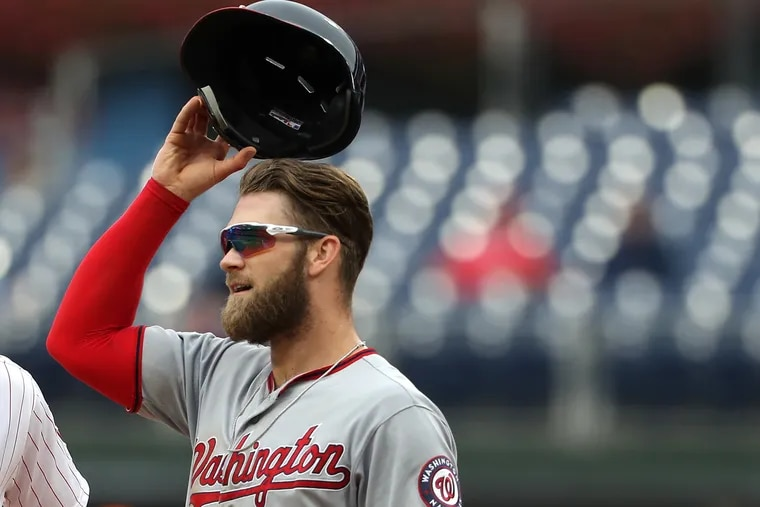 Bryce Harper of the Nationals as the umpire crew reviews the replay of a play at Citizens Bank Park on Sept. 11, 2018. CHARLES FOX / Staff Photographer