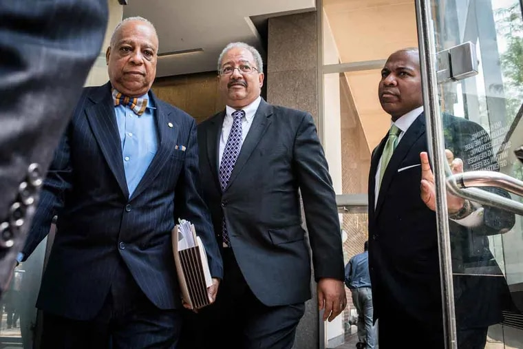 U.S. Rep. Chaka Fattah (center) leaves the federal courthouse after being convicted Tuesday, June 21, 2016, in a federal racketeering case.