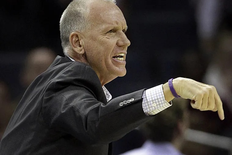 Philadelphia 76ers head coach Doug Collins directs his team against the Charlotte Bobcats during the first half of an NBA basketball game in Charlotte, N.C., Friday, Nov. 30, 2012. (AP Photo/Chuck Burton)