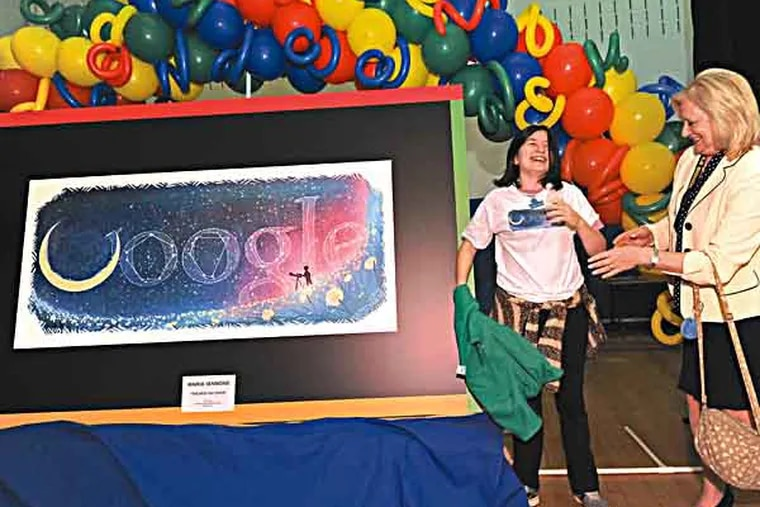 At Chestnut Ridge Middle School in Sewell, NJ, seventh grader Maria Iannone with her winning Google doodle sports a shirt with the doodle on it and gets congrats from vice principal Sheryl Lean on 5/1/13.  ( APRIL SAUL / Staff )