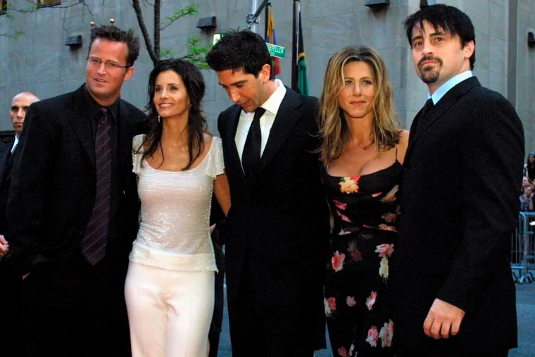 """In this May 5, 2002 file photo, the cast members, Matthew Perry, from left, Courteney Cox Arquettte, David Schwimmer, Jennifer Aniston and Matt LeBlanc of the television show """"Friends,"""" arrive at New York's Rockefeller Center for NBC's 75th Anniversary event. Netflix will still be there for fans of the old TV series """"Friends,"""" but maintaining the relationship will come at a steep price. The New York Times reported that Netflix paid $100 million to keep showing """"Friends"""" on its U.S. service through 2019. (AP Photo/Tina Fineberg, File)"""