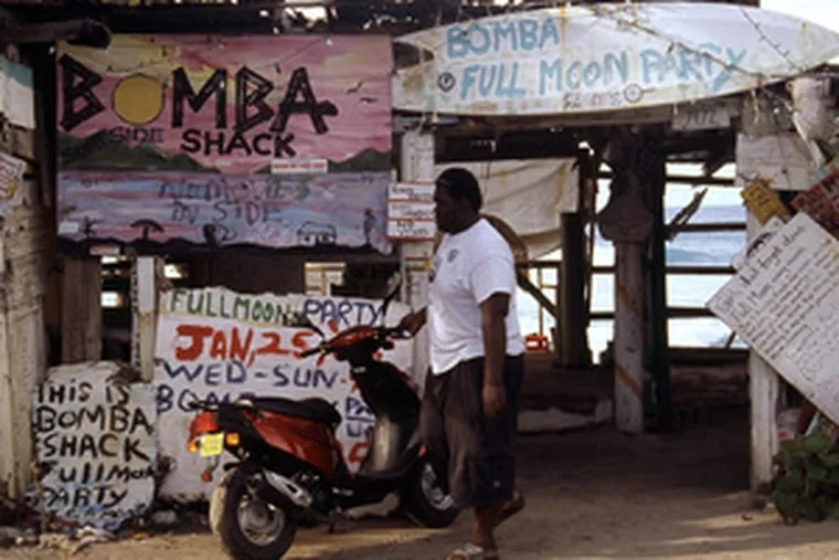 Building materials for Bomba's Surfside Shack are license plates, surfboards, toilet seats, and signboards. Live music every night of a full moon.