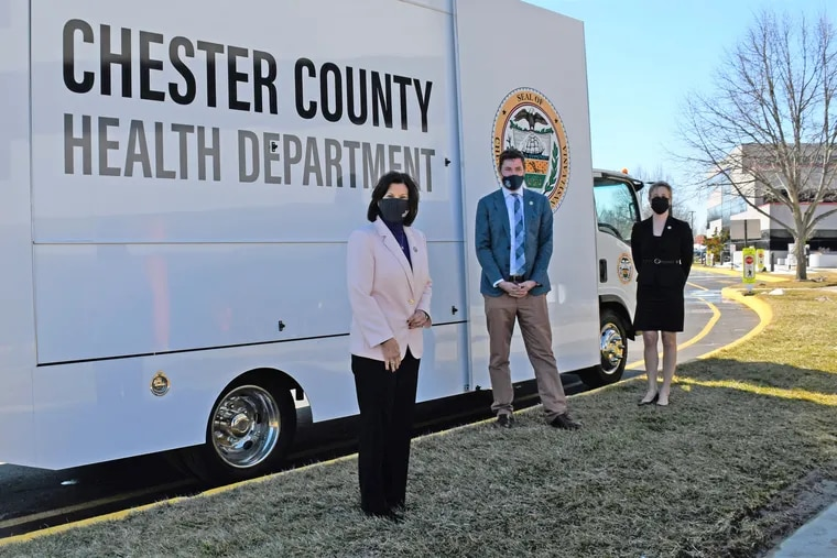 Chester County Commissioners Marian Moskowitz (foreground), Josh Maxwell, and Michelle Kichline, in front of a county Health Department mobile clinic, passed a new ethics policy to promote clean government. But it also includes a confidentiality clause for employees.