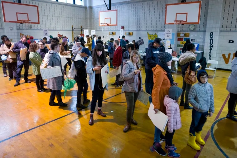 Voters stand in line to cast their ballots at P.S. 22, in the Prospect Heights neighborhood in the Brooklyn borough of New York on Nov. 6, 2018.