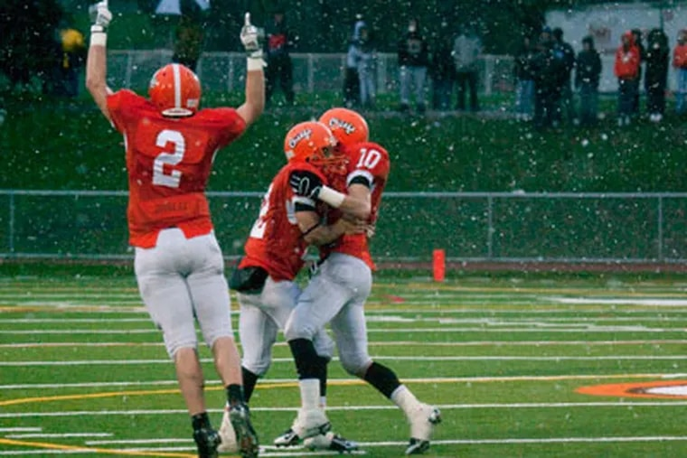 Cherokee's Tyler Powell (2) celebrates a 14-0 win over Egg Harbor at end of the 4th quarter on December 5. (Akira Suwa  /   Staff Photographer )