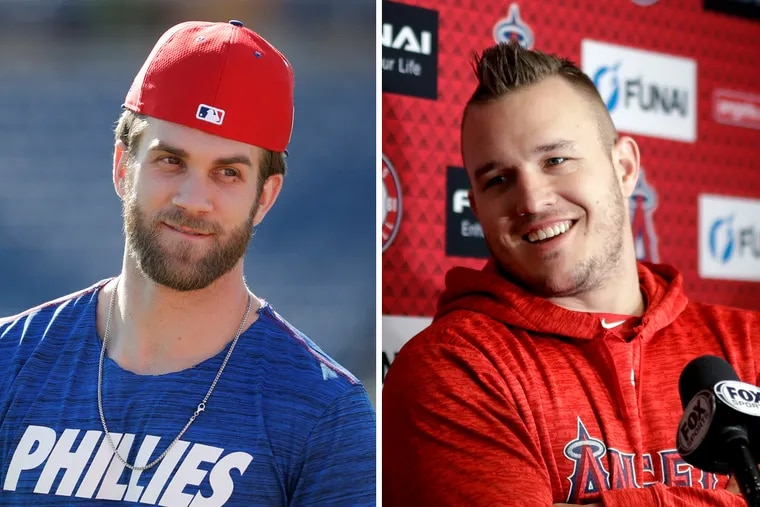 New Phillies outfielder Bryce Harper (left) has been trying to recruit Angels superstar Mike Trout (right) to Philly.