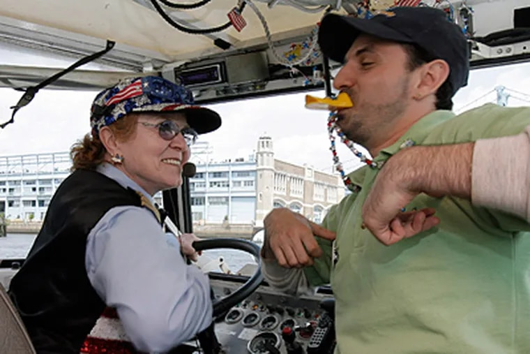 Elizabeth McKeon, 69, aka  'Captain Betsy Ross,' is the city's only  female Ride the Ducks captain. Here, she is has fun with Fred Blyweiss, tour guide and deck hand. (Akira Suwa / Staff Photographer )