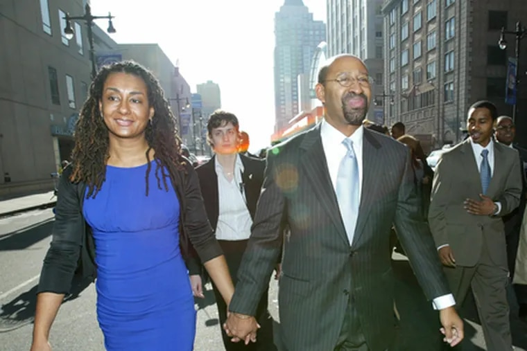 Michael Nutter walks north on Broad Street with his wife, Lisa, after being sworn in as Philadelphia's new mayor on Jan. 7.