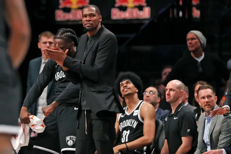 Kevin Durant applauding from the Brooklyn Nets bench during a game against the New York Knicks at the Barclays Center in November.