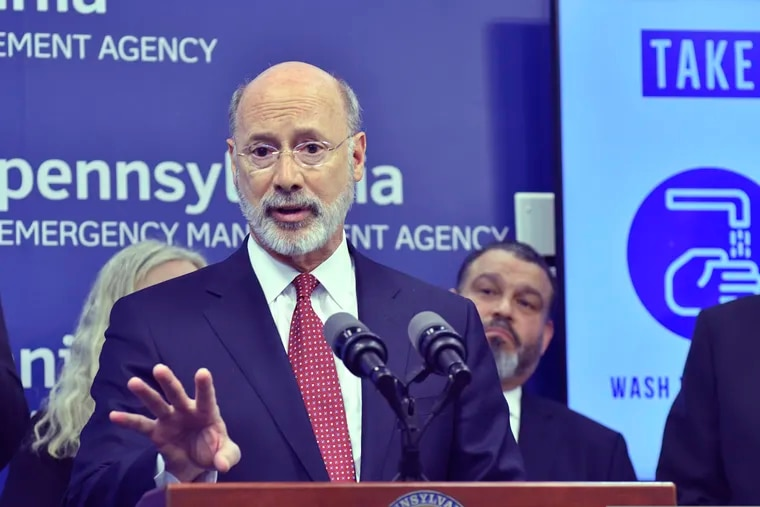 """Gov. Tom Wolf speaks at a March 12 news conference at Pennsylvania Emergency Management Headquarters in Harrisburg, where he announced the closure of schools and other facilities in Montgomery County due to the spread of the coronavirus. Late Sunday, the Pennsylvania Supreme Court denied a challenge to an order Wolf issued last week expanding the closures to all """"non-life-sustaining"""" businesses across the state."""