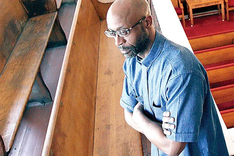 Rev. Larry G. Patrick, of Redeem Baptist Church, is seen inside his church in the Strawberry Mansion section of Philadelphia on May 6, 2014. (David Maialetti/Staff Photographer)