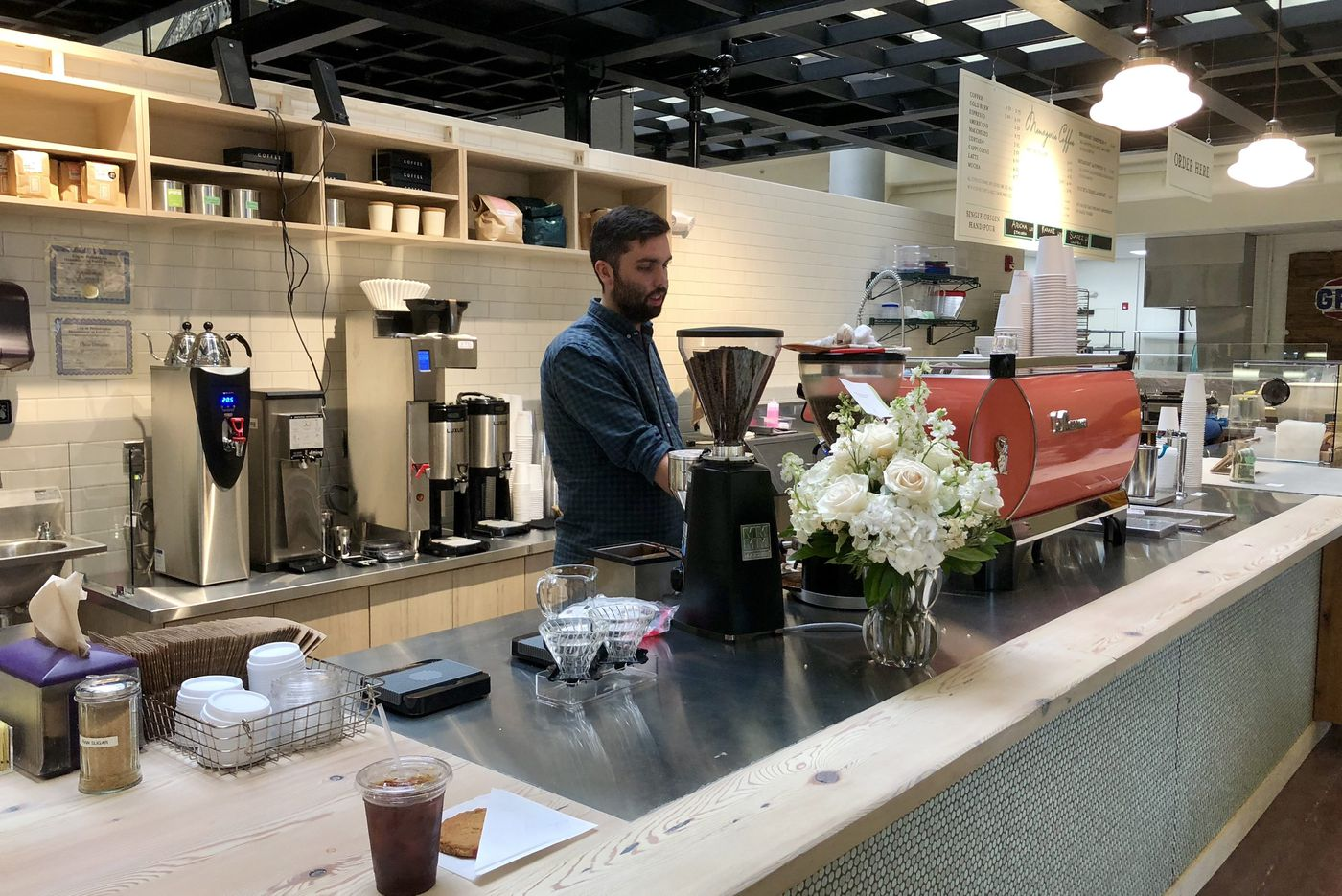 Bourse Food Hall opens softly with Menagerie Coffee