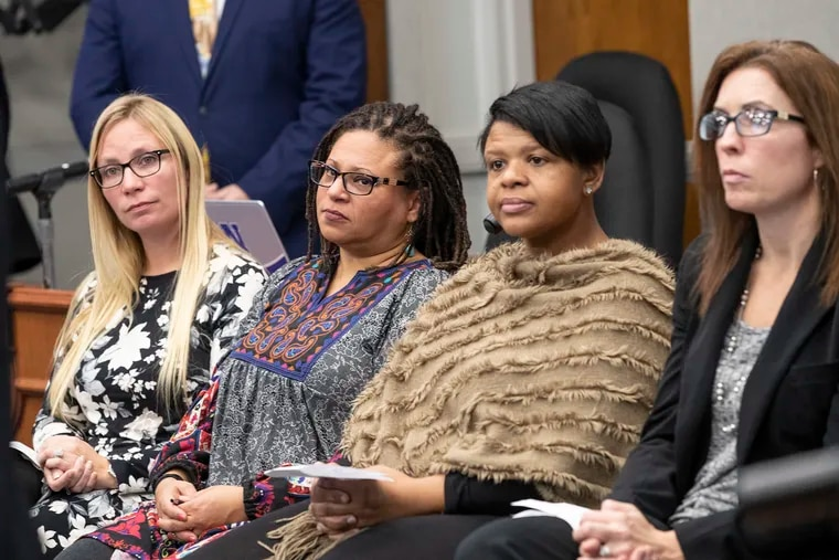 From left, Sara Aiello and Maria Loebig-Haberle, Norristown Area School District teachers, and Ericka Wharton and Melissa Retano, parents of district students, listen to speakers during a news conference Thursday , Dec. 5, 2019,  calling for charter reform at the Norristown Area School District.