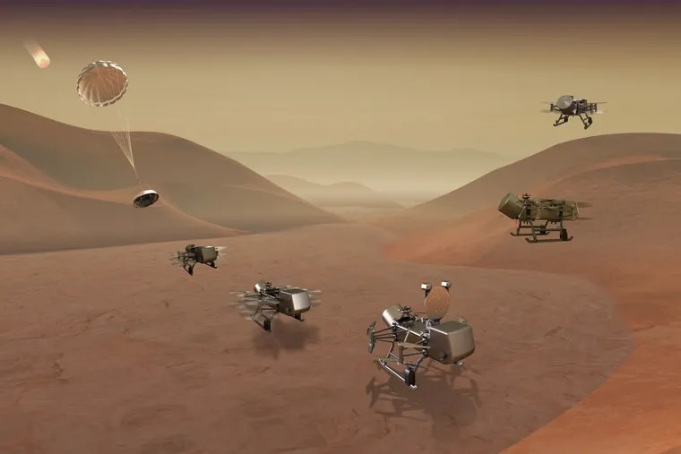 Artist rendering of Dragonfly vehicle as it comes into Titan's atmosphere and lands.