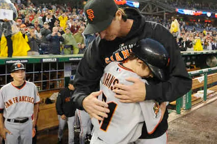 Randy Johnson hugs son Tanner after becoming the 24th pitcher to reach 300 career victories. Johnson went six innings in the Giants' 5-1 win over the Nationals.