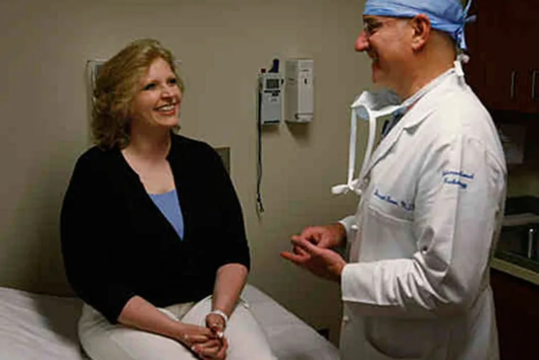 """Nasha Smith visits Joseph Bonn, the doctor who treated her. """"The procedure was so simple, yet life-changing,"""" she said. (Michael S. Wirtz / Staff)"""