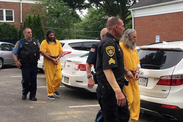 Daniel Stoltzfus (left in yellow) and Lee Kaplan (right in yellow) are led to a preliminary hearing Tuesday, Aug. 2, 2016, outside Bucks County Magisterial District Judge John I. Waltman's courtroom in Feasterville.