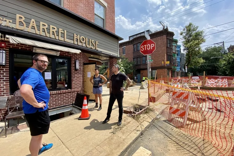 Chivonn Anderson and her business partner, Adam Volk (right), chat with fellow restaurateur Peter Woolsey (left) outside their future restaurant, Redcrest Kitchen, at Sixth and Bainbridge Streets in Philadelphia on Monday. Woolsey owns Bistrot La Minette next door.
