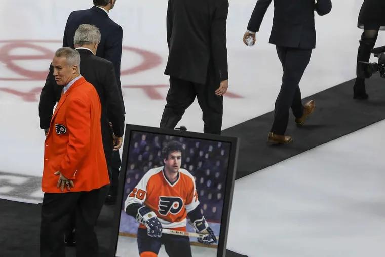 Wearing his orange blazer, former Philadelphia  defenseman Jim Watson leaves following his Flyers Hall of Fame induction ceremony Monday, February 29, 2016. STEVEN M. FALK / Staff Photographer