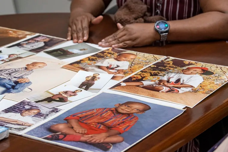 Shaleda Busbee holds a photo collage of her son, Tyrone Briggs, who died in 2019 in a Pennsylvania state prison, after staff doused him with pepper spray and failed to respond adequately to his pleas for medical treatment.