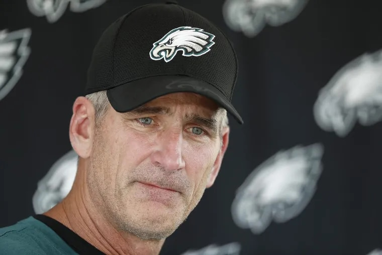 Eagles' offensive coordinator Frank Reich listens to a question during his news conference on Thursday.