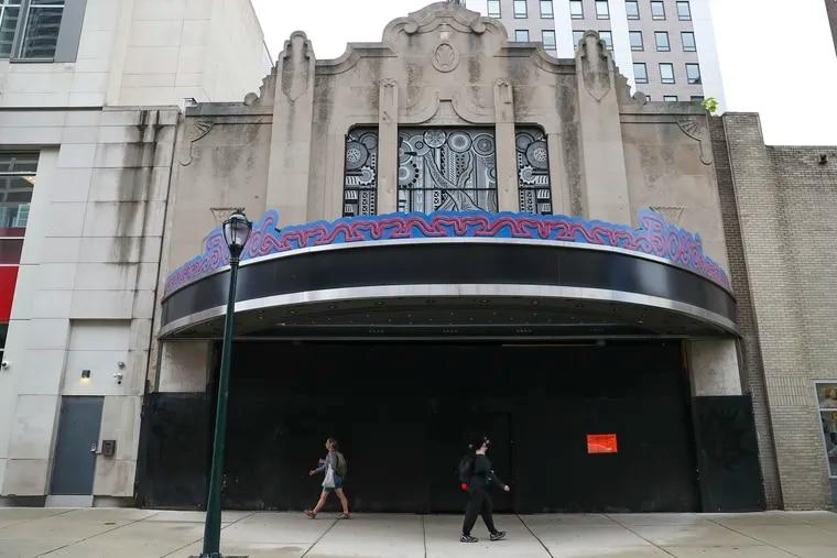 Pedestrians walk past the Boyd Theater on Chestnut Street near 19th in Philadelphia on Thursday, Sept. 9, 2021.