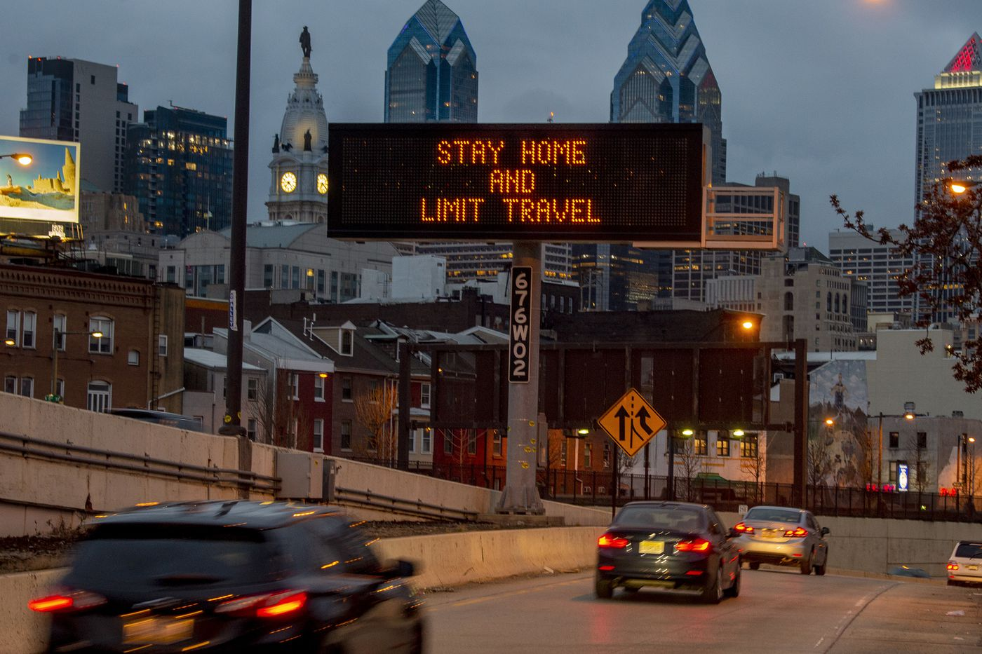 A sign at the 8th Street ramp to westbound I-676 (Vine Street Expressway) Mar. 22, 2020 reflect Philadelphia's order that all residents stay in their homes except when engaging in life-sustaining activities beginning at 8 a.m. Monday because of the coronavirus crisis.