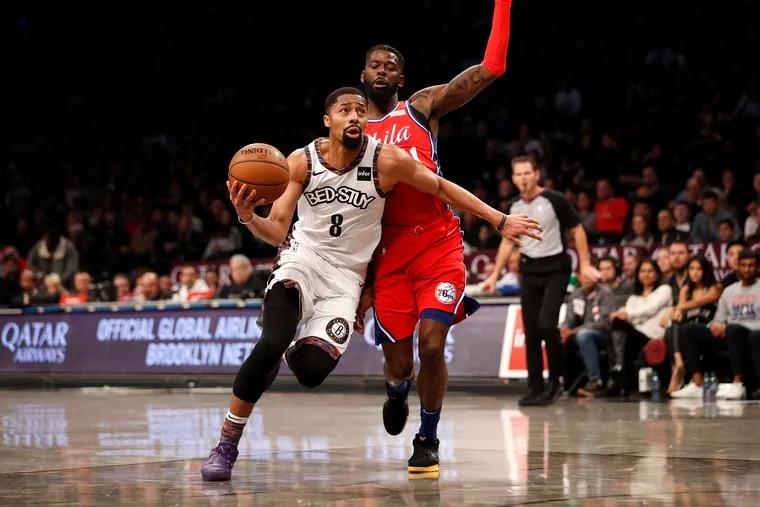 Brooklyn Nets guard Spencer Dinwiddie (8) drives against Philadelphia 76ers forward James Ennis III during the second quarter.
