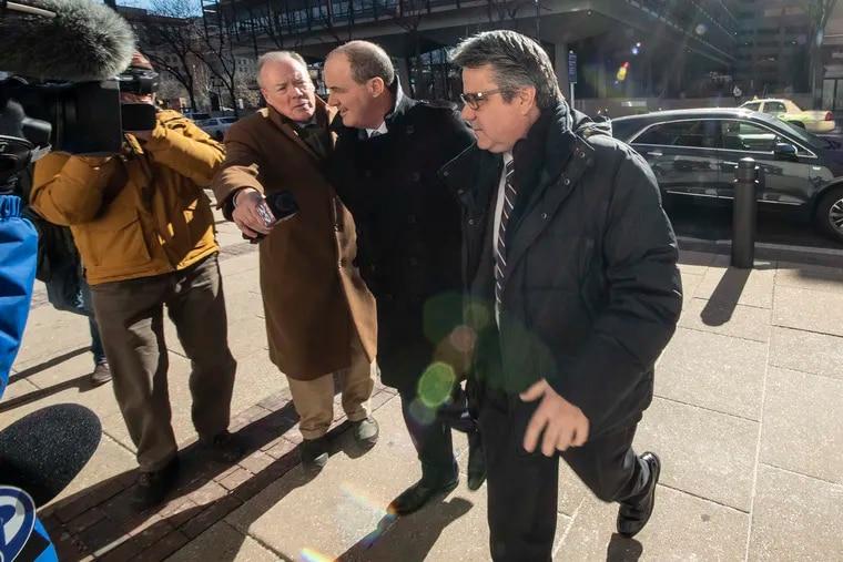 City Councilman Bobby Henon (right) enters Federal Court in Philadelphia on Thursday.