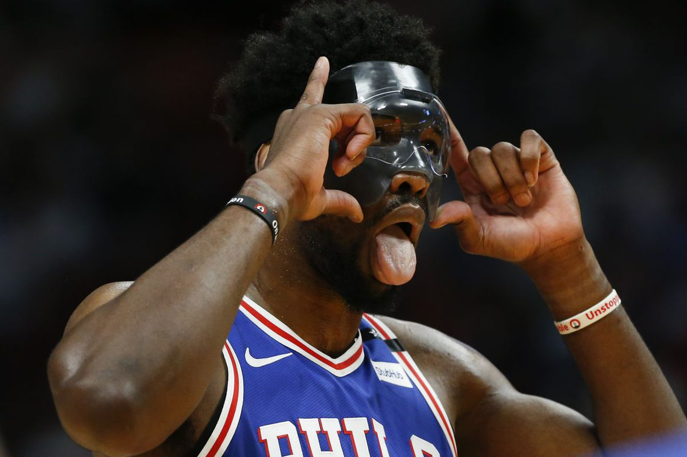 Joel Embiid and the mask make NBA playoff debut in Sixers' win over Heat