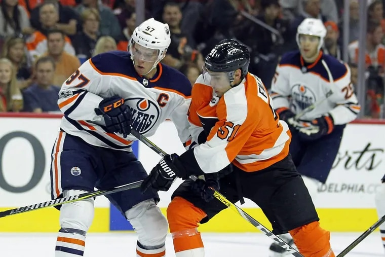 Edmonton's Connor McDavid (left) and Val Filppula battle for the puck during the Flyers' 2-1 win Oct. 21.