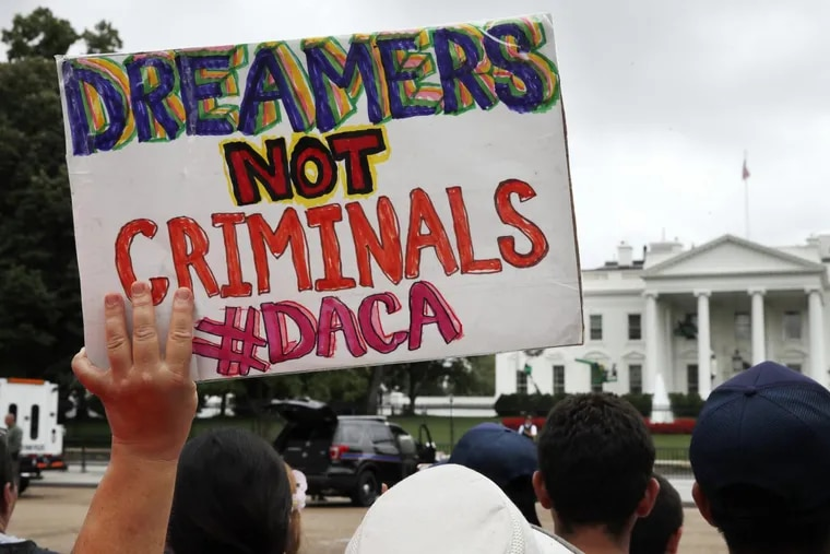 A woman holds up a signs in support of the Deferred Action for Childhood Arrivals, or DACA, during an immigration reform rally on August 15, 2017 in Washington, DC.