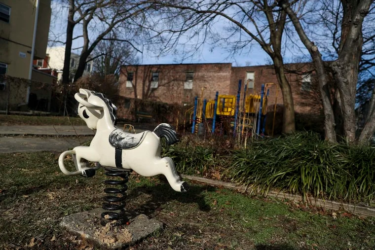 A rocking horse at the playground on 4055-57 Powelton Ave. The lot, one of four purchased by the nonprofit West Powelton Concerned Community Council for $2 total and resold for $670,000, will soon become market-price apartments with three roof decks.