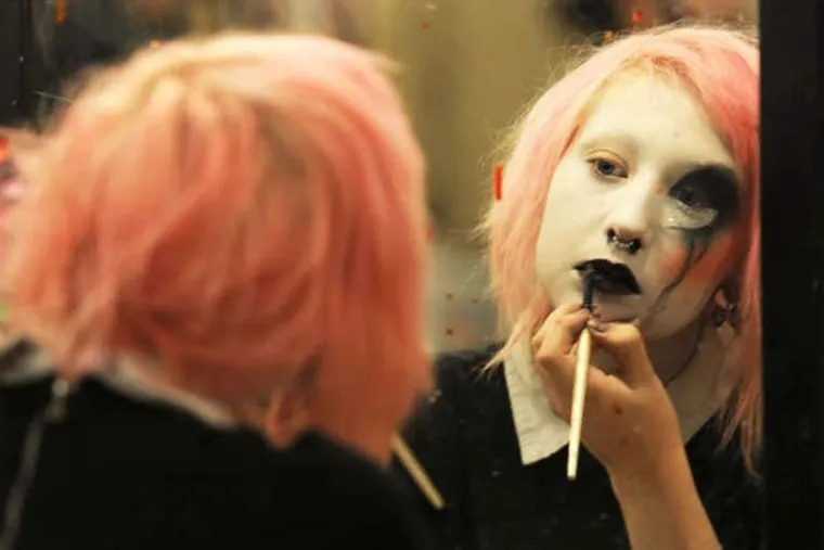 Toshi Salvino applies makeup before she and other actors start trying to scare up fun at Pennhurst Asylum. (BRADLEY C. BOWER / For The Inquirer)