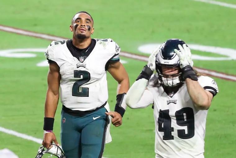 Eagles quarterback Jalen Hurts (2) and Eagles linebacker Alex Singleton walk off the field following a 33-26 loss to the Arizona Cardinals.
