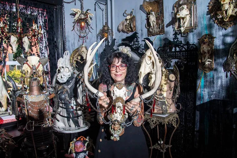 Sue Moerder is surrounded by her skull art at her private home studio in Northern Liberties.