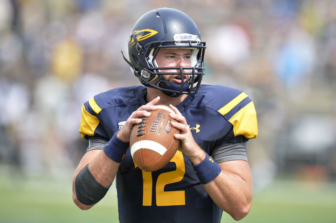 Toledo quarterback Ely endured a difficult path