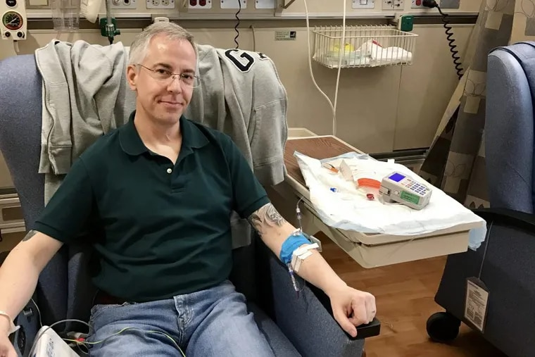Michael Becker getting an infusion of an experimental cancer immunotherapy in May.