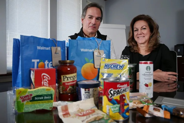 Doug Guyer, BrandShare president and CEO, and his sister Kathie Tuoni, chief operating officer, in the product-sampling company's Berwyn headquarters with items  included in tote bags being offered to first-time Walmart online grocery customers.