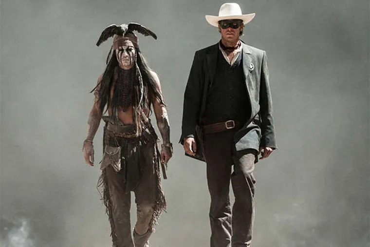 """Johnny Depp (left) as Tonto and Armie Hammer as """"The Lone Ranger."""" The crew spent nine months in five Western states, and Hammer and his costars went through three weeks of riding """"boot camp."""""""