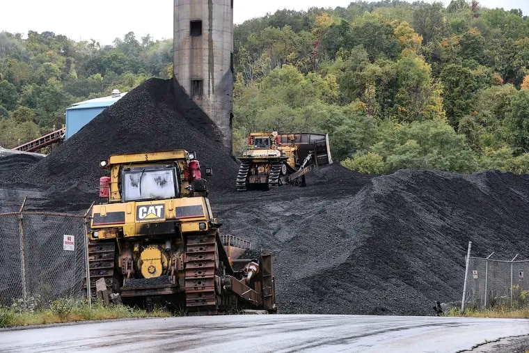 A bulldozer moves coal at the Cumberland Coal Mine in Franklin Township in September.